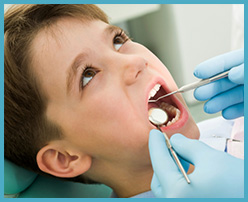 A Picture Of A Kid Being Attended At Smile First Family Dental Studio