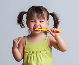A Picture Of A Girl Brushing Her Teeth